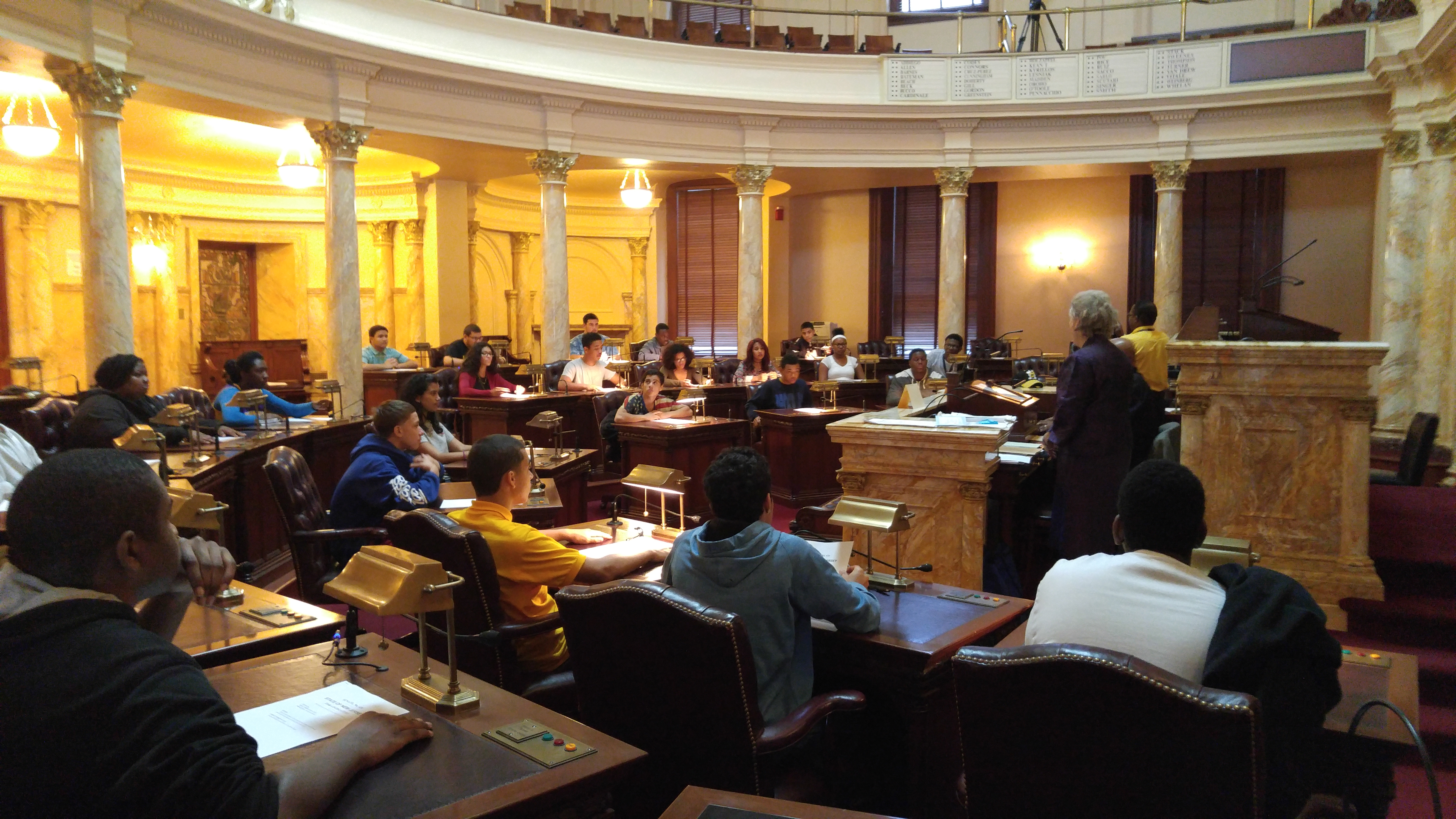 Students sitting in the State House in Trenton.